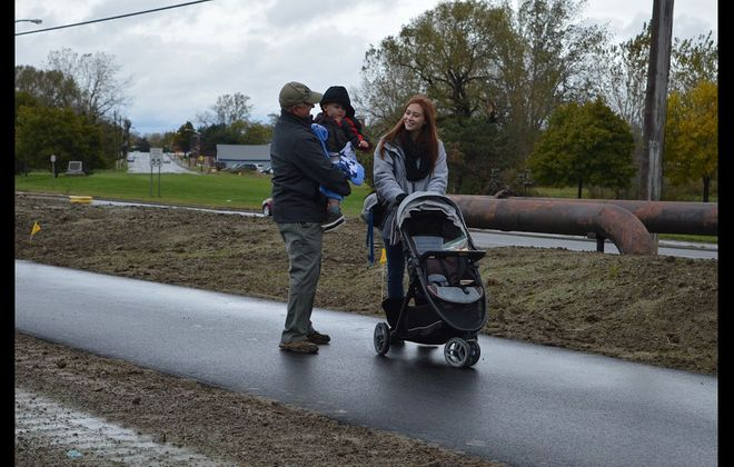 Local residents make use of the new  Shoreline Trail extension fronting the Bethlehem Steel site. (Courtesy of Erie County)