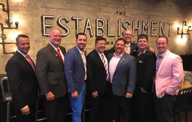 This year's Real Men Wear Pink participants include, from left, Joe DiLeo, Martin Griffith, Trevor Large, Dr. Richard Vienne, Joe Cantafio, Duane Schoonmaker, Jason Przepiora, and Chris Green. (Photo courtesy of the American Cancer Society)