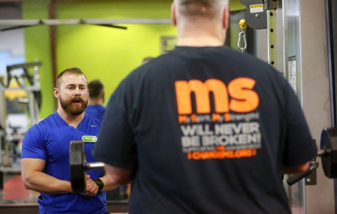 Tony Ferro, founder and leader of the WNY-based Change MS, works out with personal trainer Bret Tinder at Catalyst Fitness in Cheektowaga. A growing body of research into multiple sclerosis suggests that exercise and a healthy diet can help control the neurological disease. (Mark Mulville/News file photo)