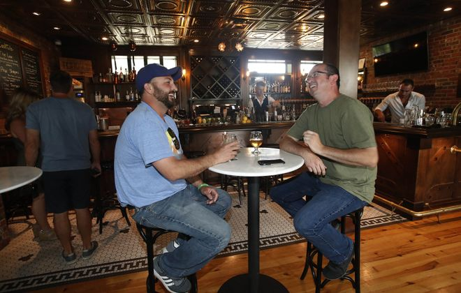 Bob Barrali, left, and Terry Rothchild, both of Buffalo, hang out at the Terrace at Delaware Park, which will host Cider Fest. (Sharon Cantillon/News file photo)