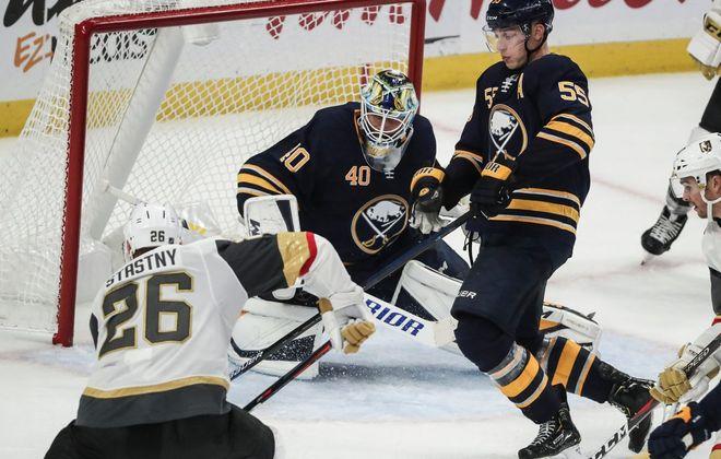 Carter Hutton and Rasmus Ristolainen defend against Vegas' Paul Stastny. (James P. McCoy/Buffalo News)