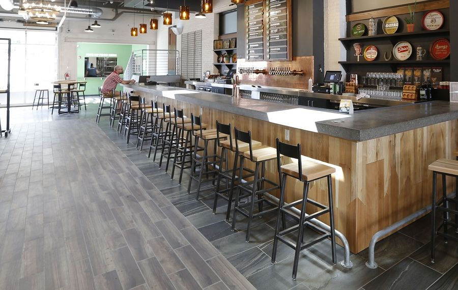 Community Beer Works' taproom remains empty, even though indoor seating has been permitted at 50% capacity. And the West Side brewers are far from the only business to make that choice. (Robert Kirkham/News file photo)