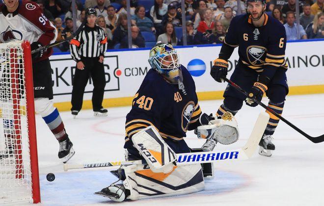 Carter Hutton and Marco Scandella can't do anything to stop Nathan MacKinnon's second-period goal. (Sharon Cantillon/Buffalo News)