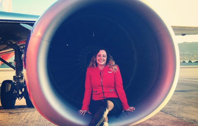 Julianne Bruyer poses on the engine of a Southwest plane, where she works as a flight attendant. (Photo courtesy Julianne Bruyer)