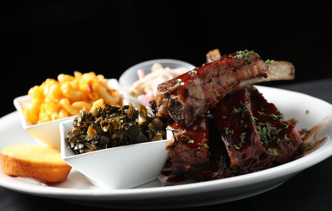 Je Ne Sais Quoi's spare rib dinner comes with cornbread and two sides, like collard greens and mac and cheese. (Sharon Cantillon/Buffalo News)