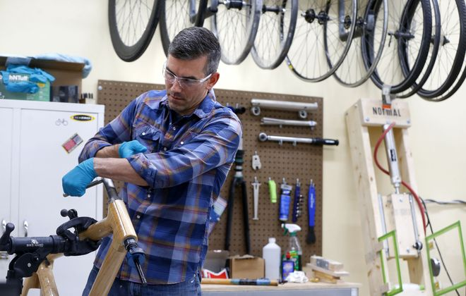 Chris Kudla builds a bike at his shop in the Foundry in Buffalo. (Mark Mulville/Buffalo News)