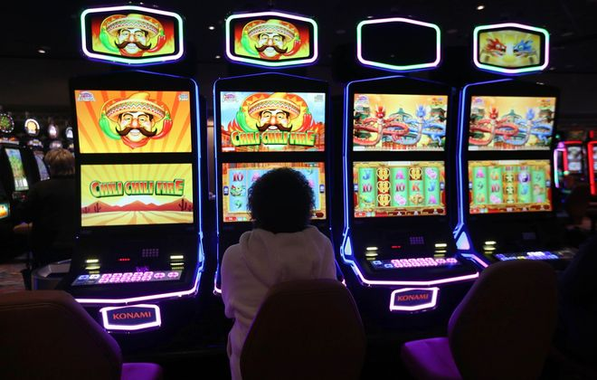 A customer plays a slot machine in Seneca Buffalo Creek Casino. (Sharon Cantillon/News file photo)