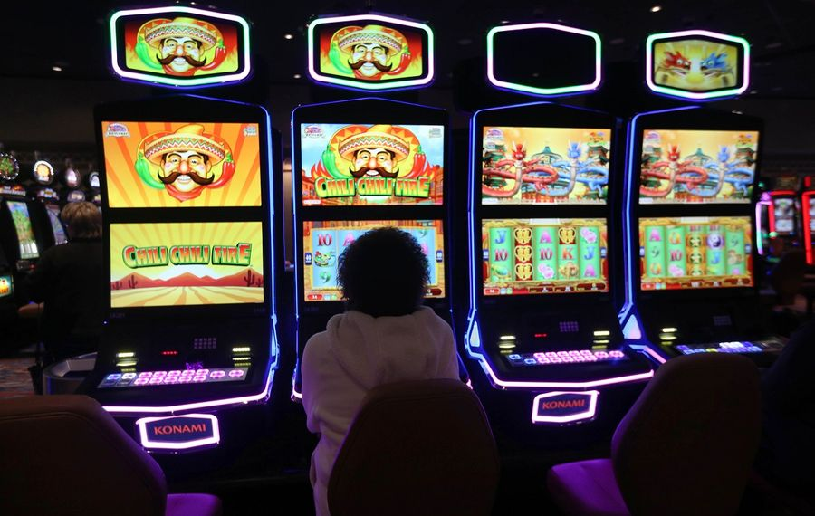 A customer plays a slot machine in Seneca Buffalo Creek Casino. (Sharon Cantillon/News file photo)
