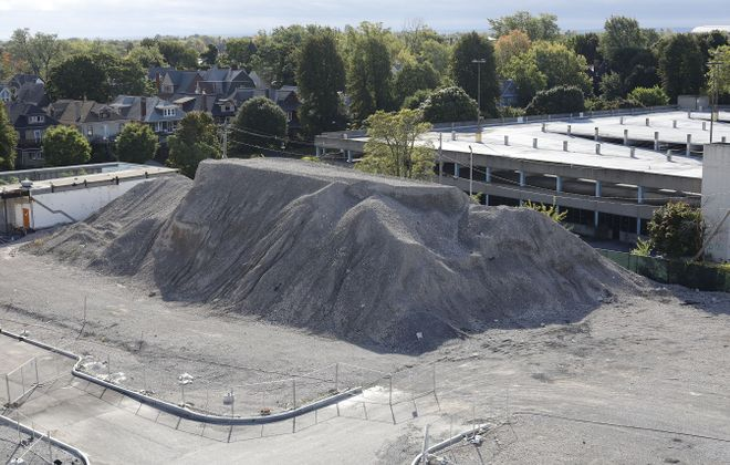 The owner of the Canterbury Woods retirement communities in Amherst and Buffalo has sued the developer of the former Millard Fillmore Gates Circle Hospital for failing to complete a promised roadway and leaving an enormous pile of dirt and debris. (Derek Gee/Buffalo News)