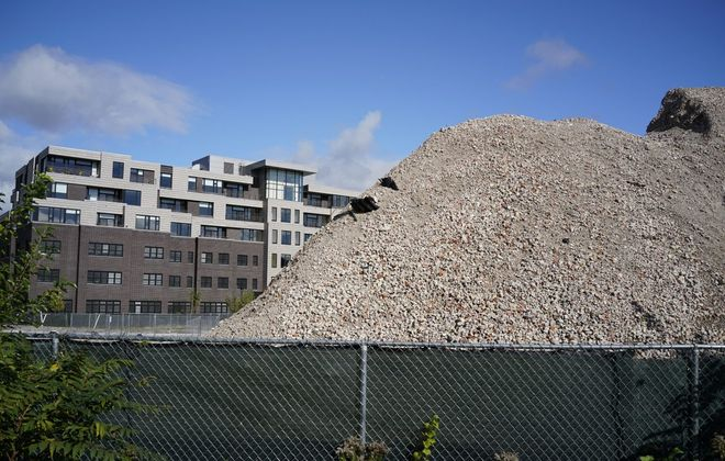 Residents at the new Canterbury Woods facility at Gates Circle have complaints about a three-story tall pile of rubble on the neighboring site of the former Millard Fillmore Hospital being developed by TM Montante. (Derek Gee/Buffalo News)