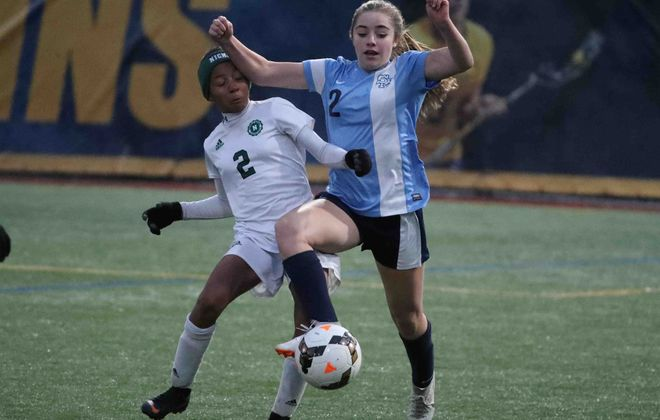 Nichols Sierra Warren, left, battles St. Mary's Shae O'Rourke for the ball in the first half (James P. McCoy/Buffalo News)