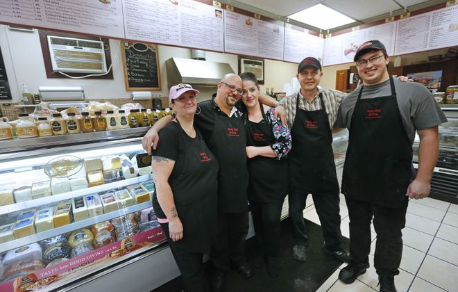 The full crew at Depew Deli, from left, is Mary Cooper, owners Willy and May Suleiman, chef Eric Willert and clerk Andrew Galas take a break to pose for a group photo. (Robert Kirkham/Buffalo News)