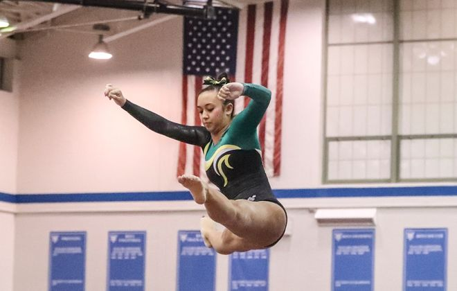 Williamsville North's Madison Penetrante performs on the balance beam in the Section VI gymnastics finals at Kenmore East High School in Kenmore on Friday. (James P. McCoy/Buffalo News)