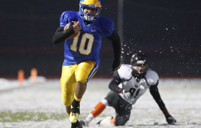 Cleveland Hill's Aaron Wahler runs for a touchdown against Warsaw-Letchworth. (Harry Scull Jr./Buffalo News)