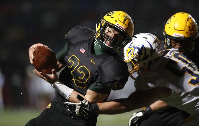 West Seneca East quarterback Shaun Dolac scores on a two-point conversion against Irondequoit during last week's Far West Regional. (Harry Scull Jr./Buffalo News)