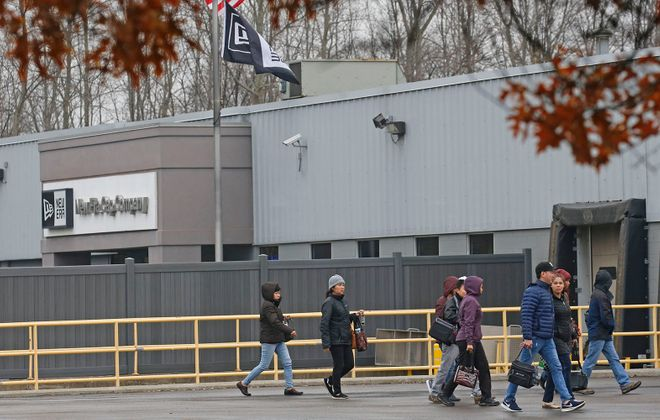 Shortly after the New Era Cap location in Derby informed workers that they will probably be closing their workplace in March 2019, employees leave the facility on Tuesday, Nov. 13, 2018.  (Robert Kirkham/Buffalo News)