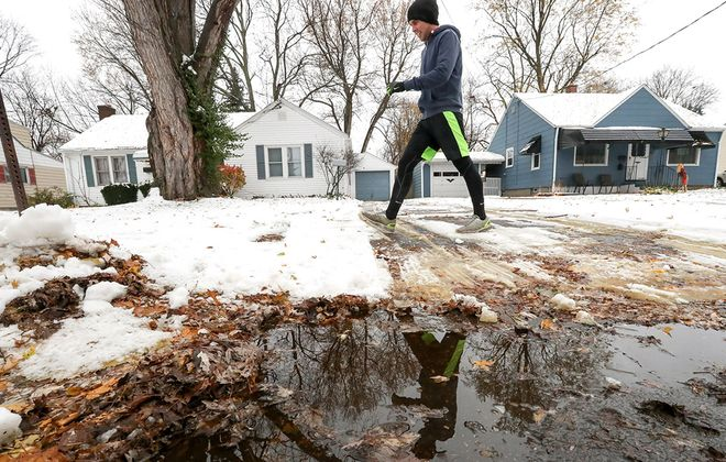 A warmup, and some weekend rain, should help to melt most of the fallen snow in metro Buffalo. (James P. McCoy/News file photo)