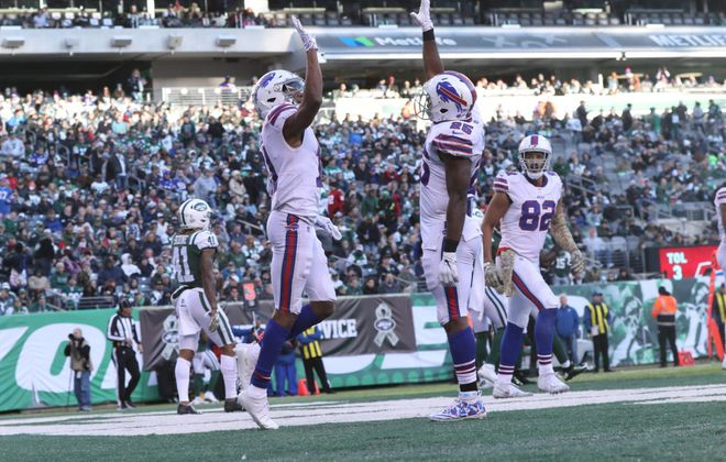 Bills wide receiver Zay Jones gets high fives from Bills running back LeSean McCoy after catching a pass for a touchdown in the third quarter. (James P. McCoy/Buffalo News)