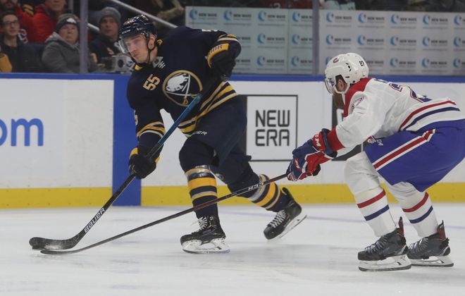 Rasmus Ristolainen fires as Montreal's Karl Alzner  closes in. (John Hickey/Buffalo News)