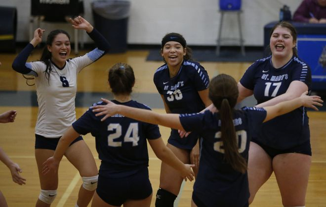 St. Mary's celebrates a point against Sacred Heart Academy during the New York State Catholic High School Athletic Association 2018 State Volleyball Championships at St. Mary's High School, Saturday, Nov. 10, 2018. (Derek Gee/Buffalo News)
