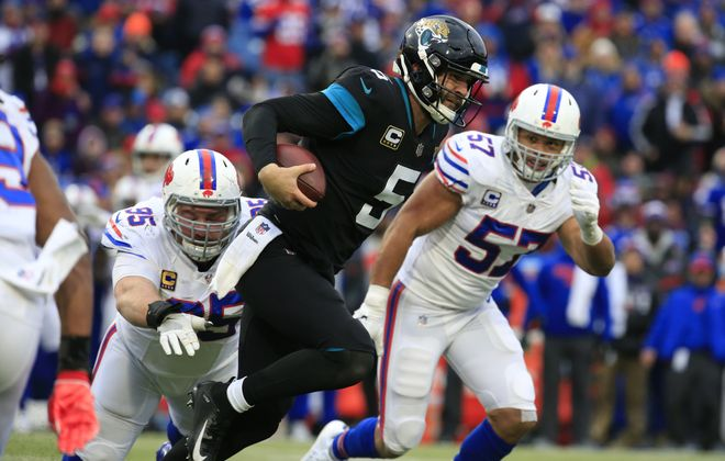 Bills defensive lineman Kyle Williams tackles Jaguars quarterback Blake Bortles during the third quarter (Harry Scull Jr./ Buffalo News)
