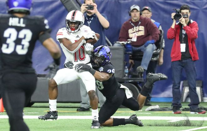 Northern Illinois wide receiver D.J. Brown  catches the game-winning touchdown over Bulls cornerback Cameron Lewis. (James P. McCoy/Buffalo News)