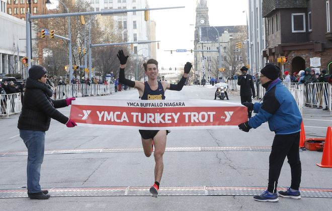 Chad Maloy is the winner for the third year in a row in Thursday's YMCA Turkey Trot. (Sharon Cantillon/Buffalo News)