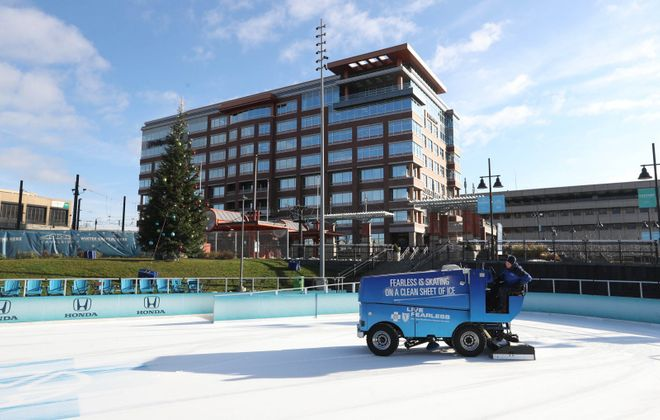Nick Berst of Canalside Buffalo runs the zamboni over the ice in preparation for opening day on Friday. (Sharon Cantillon/Buffalo News)