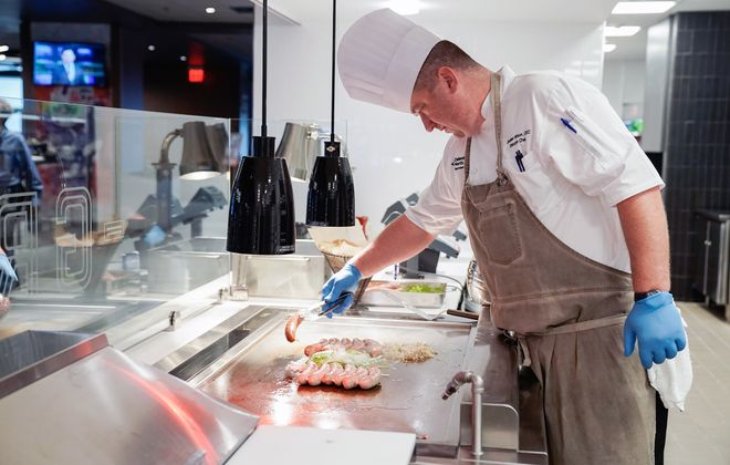 Chef Jonathan Wilson often spends Christmas Eve cooking for Buffalo Bills players and their families in his kitchen at New Era Field. (Dave Jarosz)