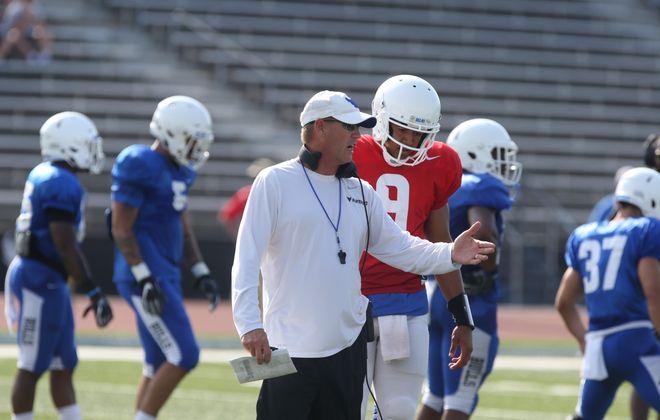UB football coach Lance Leipold, left, talks with quarterback Dominic Johnson during a preseason scrimmage. (John Hickey/News file photo)