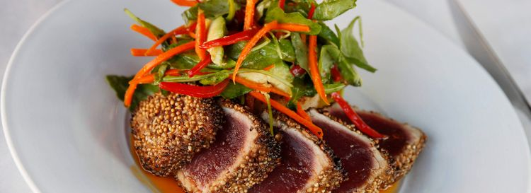 Bacchus' ahi tuna is crusted with coriander and glazed with a citrus chili sauce, served on a crispy rice cake with an avocado salad. (Sharon Cantillon/News file photo)