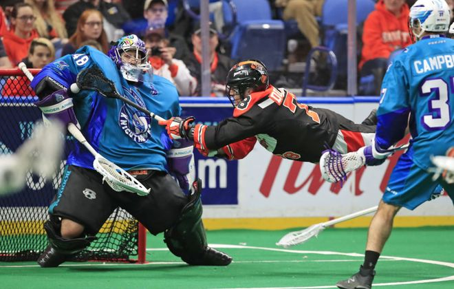 Buffalo Bandits Jordan Durston is stopped by Rochester Knighthawks goaltender Matt Vinc on Feb. 24, 2018, at the KeyBank Center. (Harry Scull Jr./News file photo)
