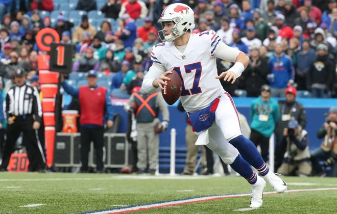 Buffalo Bills quarterback Josh Allen looks for a receiver downfield during the first quarter against the Jacksonville Jaguars in November 2018. (James P. McCoy/Buffalo News)