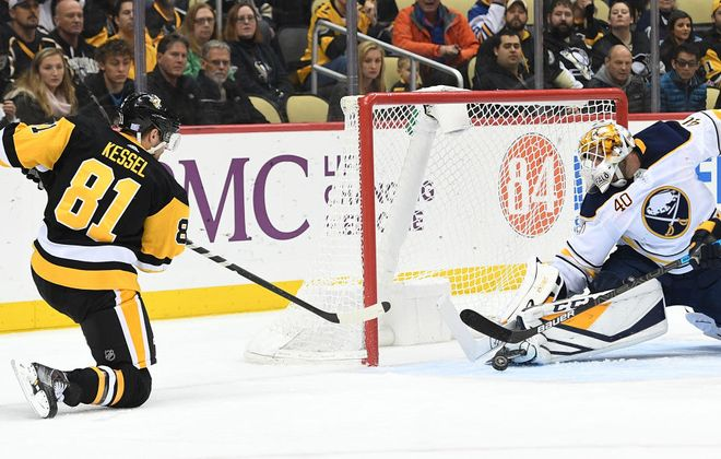 Sabres Carter Hutton makes a save on a shot by the Penguins' Phil Kessel in the second period Monday. (Justin Berl/Getty Images)