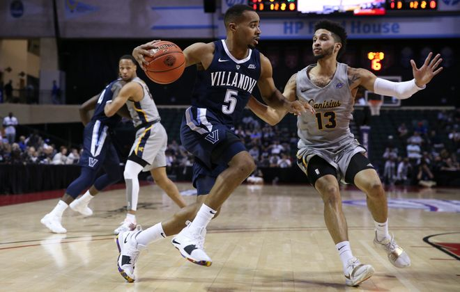 Villanova guard Phil Booth (5) drives the ball past Canisius guard Isaiah Reese (13) during the 2018 AdvoCare Invitational Thursday at the HP Field House in Orlando, Fla. The Griffs' Reese scored 19 points. (Photo by Mark LoMoglio/Icon Sportswire via Getty Images)