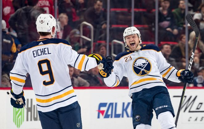 Sam Reinhart of the Buffalo Sabres celebrates his game-winning shootout goal with teammate Jack Eichel against the Detroit Red Wings at Little Caesars Arena on Nov. 24, 2018 in Detroit. (Photo by Dave Reginek/NHLI via Getty Images)