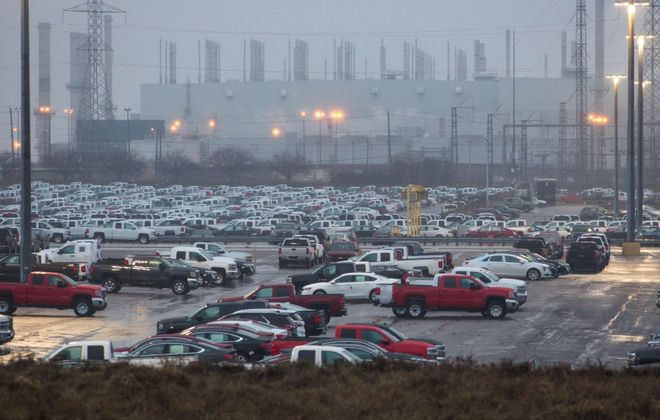 Hundreds of General Motor vehicles are parked outside the GM Assembly plant in Oshawa, Ontario.   (Lars Hagberg/AFP/Getty Images)