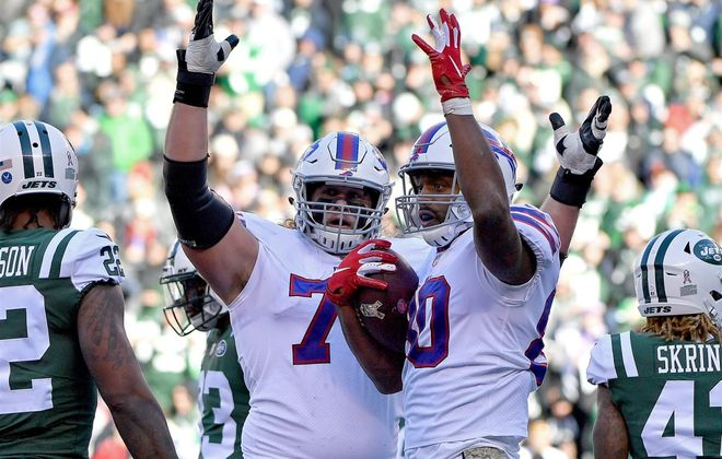Bills rookie guard Wyatt Teller, left, celebrates Jason Croom's touchdown against the Jets. (Getty Images file photo)