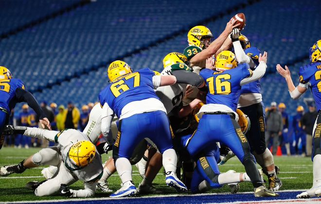 Shaun Dolac extends the ball past the plane of the goal line to break a 13-13 tie during West Seneca East's triumph over rival West Seneca West in the Section VI Class A final at New Era Field. (Harry Scull Jr./Buffalo News)