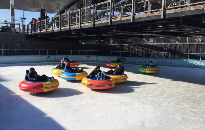 Visitors to the Ice at Canalside give the new ice bumper cars a spin. (Keith McShea/Buffalo News)
