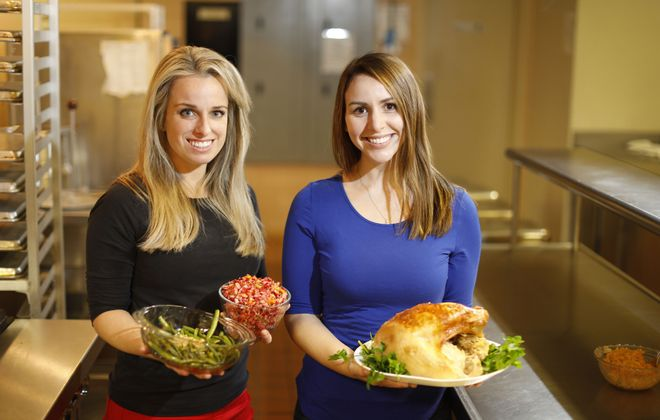 Jenny Arnette, left, and Alanna Bonaccorso, fourth-year students in the five-year master's of Dietetics Program at D'Youville College recently prepared a Thanksgiving dinner with a few healthy twists in the College Dietetics Lab Kitchen. (Derek Gee/Buffalo News)