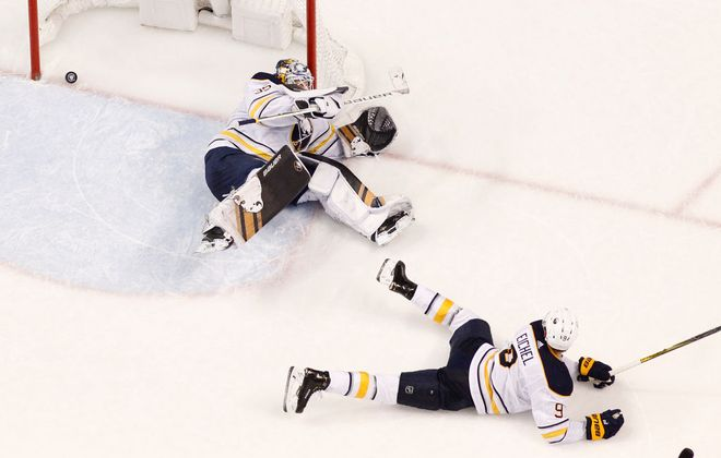 Jack Eichel and goaltender Linus Ullmark can't stop Aleksander Barkov's shot in overtime. (Getty Images).