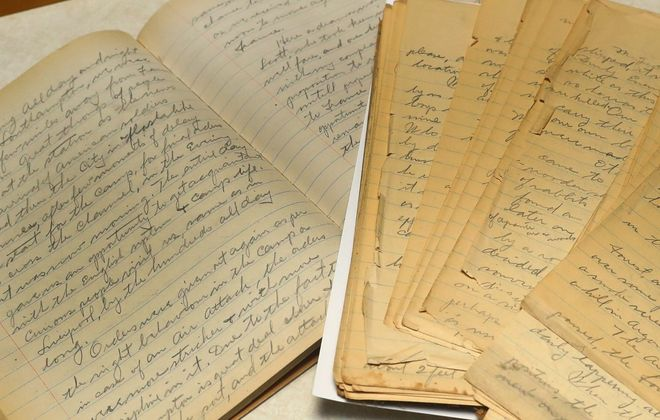 WWI Army veteran Louis Pawelski of Buffalo wrote a 310-page war journal that his grandson Bob Pawelski recently discovered in his mother's garage. Louis Pawelski wrote about mustard gas attacks and fighting German soldiers up to the minute the war ended at 11 a.m. Nov. 11, 1918. Bob Pawelski, a Lake View resident, and his family transcribed his grandfather's journal into a 93-page digital journal.   (John Hickey/Buffalo News)