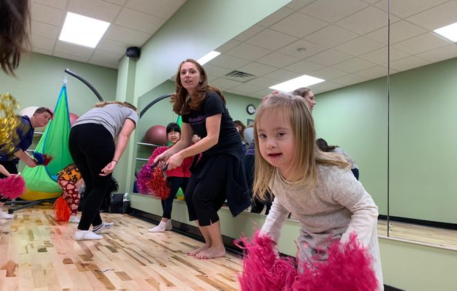 Molly Furminger, 5, of Clarence, participates in a Monday night dance and movement class under the watchful gaze of Christine Dwyer, co-founder and senior instructor at Danceability, which moved into a larger space on George Urban Boulevard in Depew last month. (Photos by Scott Scanlon)
