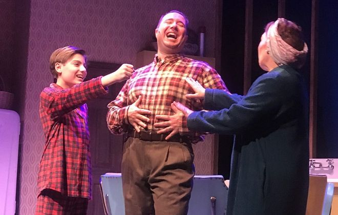 """Michael Scime, Jacob Albarella and Wendy Hall star as members of the Pazinski family in the world premiere of """"Christmas Over the Tavern"""" at MusicalFare Theatre. (Photo by Doug Weyand.)"""