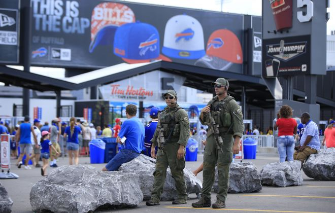 Erie County SWAT team members walk the outside perimeter of New Era Field. The Sheriff's Office wants to upgrade the county's SWAT unit from part time to full time in 2020., but that's unlikely to happen. (Harry Scull Jr./News file photo)