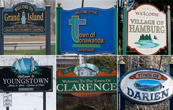 Municipal signs are a colorful patchwork celebrating the unique identities of Western New York's cities, towns and villages. Youngstown's marker sports a smaller sign noting the village is the hometown of Daryl Johnston of the Dallas Cowboys. (Robert Kirkham/Buffalo News)