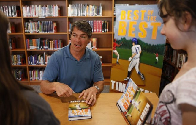 "Tim Green signed copies of his book ""Best of the Best"" for students at Depew Middle School in 2011. (Derek Gee / Buffalo News)"