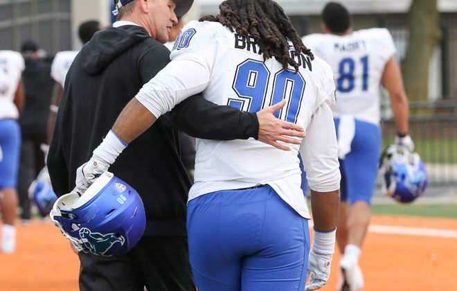 University of Buffalo coach Lance Leipold congratulates defensive lineman Justin Brandon at the conclusion of the Bulls' game against Bowling Green at Doyt L. Perry Stadium in Bowling Green, Ohio on Nov. 23, 2018.  (Photo by Scott W. Grau)
