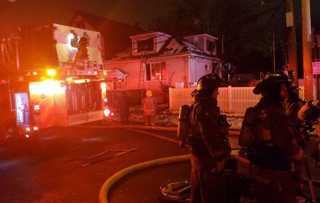 Buffalo firefighters battle a garage fire Friday at West Ferry Street and Colorado Avenue. (Harold McNeil/Buffalo News)
